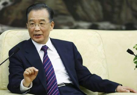 Chinese Premier Wen Jiabao answer a question during a meeting with entrepreneurs from various countries at China Development Forum at the Great Hall of the People in Beijing March 22, 2010. REUTERS/Feng Li/Pool/Files