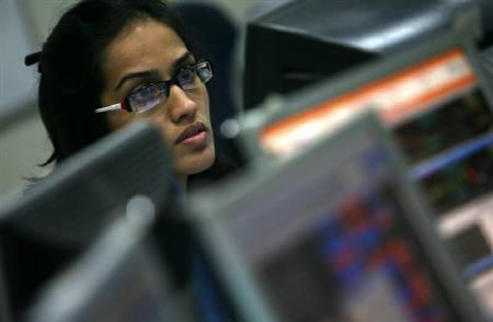 A broker looks at a computer screen at a stock brokerage firm in Mumbai in this July 2009 file photo. REUTERS/Arko Datta