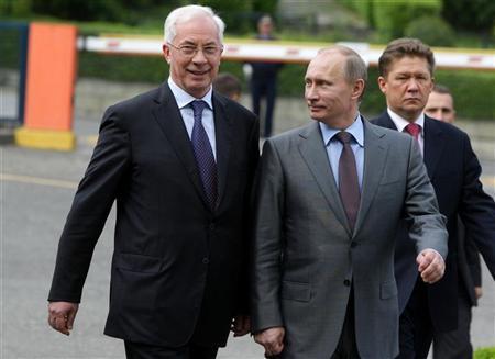 Russian Prime Minister Vladimir Putin (C), his Ukrainian counterpart Mykola Azarov (L) and Gazprom Chairman Alexei Miller walk after talks at Russia's Black Sea resort of Sochi, April 30, 2010. REUTERS/RIA Novosti/Pool/Alexei Druzhinin