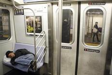 <p>A man sleeps while riding the subway in New York, April 20, 2009 file photo. REUTERS/Lucas Jackson</p>