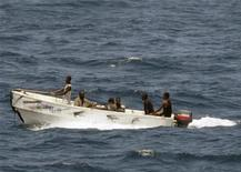 <p>Pirates leave the merchant vessel MV Faina (not shown) for the Somali shore, while under observation by a U.S. Navy ship, in this picture taken on October 8, 2008 and released October 9. REUTERS/Jason R. Zalasky</p>