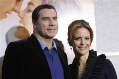 """<p>Cast member Kelly Preston and her husband John Travolta pose at the premiere of """"The Last Song"""" at the Arclight theatre in Hollywood, California March 25, 2010. The movie opens in the U.S. on March 31. REUTERS/Mario Anzuoni</p>"""