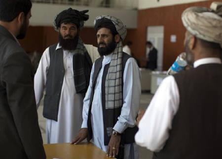 Afghan delegates register to attend the upcoming peace ''Jirga'' assembly in Kabul May 30, 2010. With the U.S. endgame in sight, Afghanistan's direct and near neighbours have stepped up efforts to undercut each other, advance strategic interests and exert influence on a negotiated settlement of the nine-year conflict. REUTERS/Ahmad Masood/Files