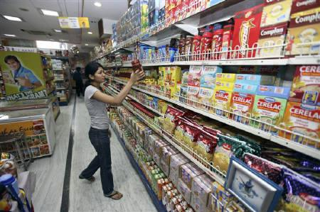 A customer shops at a grocery store in Lucknow July 6, 2009. Stock funds that invest in consumer goods and pharma sectors led mutual fund gainers in May, while diversified equity funds fell in line with the benchmark as key stock indices dropped on euro zone worries. REUTERS/Pawan Kumar/Files