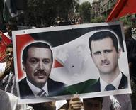 <p>Palestinians refugees living in Syria take part in a rally against Israel as they hold a poster of Syria's President Bashar al-Assad (R) and Turkey's Prime Minister Tayyip Erdogan, at al-Yarmouk camp near Damascus, June 4, 2010. REUTERS/Khaled al-Hariri</p>