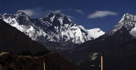 The moonlit Everest mountain range is seen from Syangboche in Nepal December 4, 2009. Increased melting of glaciers and snow in the Himalayas and Tibetan Plateau threatens the food security of millions of people in Asia, a study shows, with Pakistan likely to be among the nations hardest hit. REUTERS/Gopal Chitrakar/Files