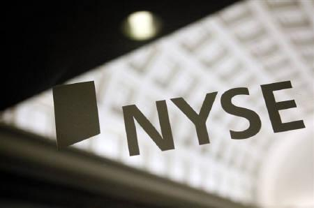 The sign of the New York Stock Exchange is seen on a door June 23, 2009. REUTERS/Eric Thayer/Files