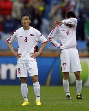 North Korea's Ji Yun-nam (L) and An Yong-hak react after their loss to Portugal in a 2010 World Cup Group G soccer match at Green Point stadium in Cape Town June 21, 2010.     REUTERS/Carlos Barria