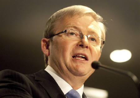 Australia's Prime Minister Kevin Rudd delivers a speech to the Perth Press Club as demonstrators protested nearby against the government's proposed super profits mining tax in Perth June 9, 2010. REUTERS/Ron D'Rain/Files