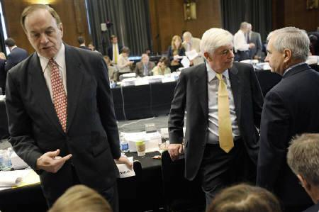 Senate Banking Committee Ranking Member Richard Shelby, Chairman Christopher Dodd and Senator Jack Reed wait for the end of a recess from a committee conference on Wall Street reform to hammer out sweeping changes in financial regulation legislation on Capitol Hill, in Washington June 24, 2010. REUTERS/Jonathan Ernst