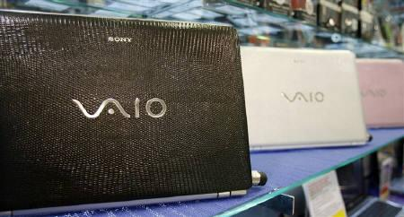 Sony Vaio laptops sit on a display stand at a showroom in Singapore September 5, 2008. REUTERS/Vivek Prakash/Files