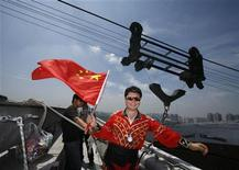 "<p>Adili Wuxor, known as ""Prince of the Tightrope"", waves the Chinese national flag above the ""Bird's Nest"" Olympic stadium in Beijing July 2, 2010. REUTERS/Bobby Yip</p>"