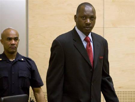 Congolese militia leader Thomas Lubanga (R) enters court at the beginning of his trial at the International Criminal Court (ICC) in The Hague January 26, 2009. REUTERS/ICC/Handout/Files