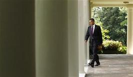 <p>President Obama walks from the Oval Office to make remarks about the Senate campaign finance reform vote in the Rose Garden of the White House, July 26, 2010. REUTERS/Kevin Lamarque</p>