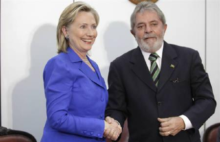 U.S. Secretary of State Hillary Clinton (L) shakes hands with Brazil's President Luiz Inacio Lula da Silva during a meeting in Brasilia March 3, 2010. The road to rock bottom for relations between Brazil and the US, a dispute that now threatens business ties between the two economic giants, began in Brasilia in March. REUTERS/Ricardo Moraes/Files