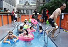 <p>People swim in one of three converted dumpster pools on Park Avenue in New York August 7, 2010. REUTERS/Shannon Stapleton</p>