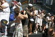 "<p>Couples participate in a ""Kiss-In"" in New York's Times Square August 14, 2007. REUTERS/Brendan McDermid</p>"