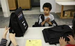 <p>Five-year-old Trey Von, who will be entering kindergarten, looks at a selection of backpacks during a free back-to-school shopping day for low-income families in San Francisco, California, August 7, 2009. REUTERS/Robert Galbraith</p>