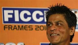 <p>Bollywood star Shah Rukh Khan smiles during the inauguration session of the 11th FICCI-FRAMES convention in Mumbai March 16, 2010. REUTERS/Punit Paranjpe</p>