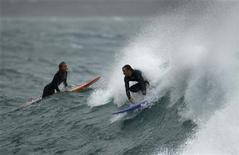 """<p>A surfer takes off at a break known as """"Fairy Bower"""" on Sydney's northern beaches May 31, 2010. REUTERS/Tim Wimborne</p>"""