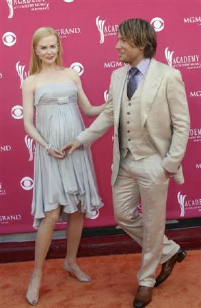 Actress Nicole Kidman and her husband, singer Keith Urban, pose as they arrive at the 43rd Annual Academy of Country Music Awards show in Las Vegas, Nevada, May 18, 2008. REUTERS/Richard Brian/Files