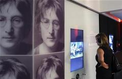 "<p>A woman watches a video at the ""John Lennon, Songwriter"" exhibit during a press preview at the Grammy Museum in Los Angeles October 1, 2010. REUTERS/Fred Prouser</p>"