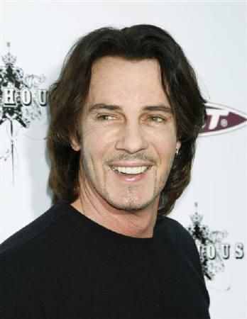 Musician Rick Springfield arrives at the premiere of ''The Joneses'' in Los Angeles, California, April 8, 2010. REUTERS/Jason Redmond/Files