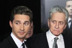"""<p>Actor and cast member Michael Douglas arrives with Shia LaBeouf (L) for the premiere of the film """"Wall Street: Money Never Sleeps"""" in New York September 20, 2010. REUTERS/Lucas Jackson</p>"""