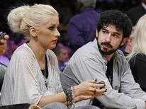 <p>Singer Christina Aguilera and her husband, music producer Jordan Bratman, attend Game 7 of the 2010 NBA Finals basketball series in Los Angeles, California, June 17, 2010. REUTERS/Lucy Nicholson</p>