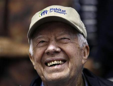 Former President Jimmy Carter attends a Habitat for Humanity home building site in the Ivy City neighborhood of Washington, October 4, 2010. REUTERS/Larry Downing