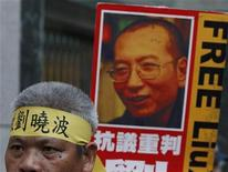 """<p>A protester wearing a headband which reads """"Liu Xiaobo"""" demonstrates outside the Chinese Foreign Ministry in Hong Kong October 8, 2010 demanding the release of jailed Chinese pro-democracy activist Liu. REUTERS/Bobby Yip</p>"""