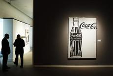 "<p>Security guards stand near ""Coca-Cola [4] Large Coca-Cola"" by Andy Warhol during a preview of Sotheby's Impressionist & Modern Art auction in New York October 29, 2010. REUTERS/Lucas Jackson</p>"