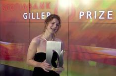 "<p>Author Johanna Skibsrud reacts after winning the Giller Prize for her book ""The Sentimentalists"" in Toronto November 9, 2010. REUTERS/Mark Blinch</p>"