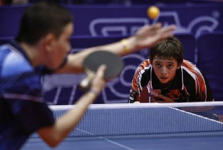 Tenti Fermin of Argentina (R) plays against Brian Afanador of Puerto Rico during the men's U13 final match at the XI Latin-American table tennis Championships in Santo Domingo October 10, 2010. REUTERS/Eduardo Munoz