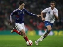 <p>Lance do amistoso entre França e Inglaterra, disputado em Wembley, e vencido pela seleção francesa por 2 x 1. REUTERS/Eddie Keogh</p>