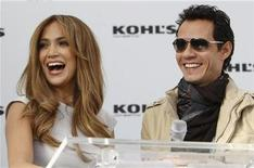 <p>Jennifer Lopez (L) and her husband Marc Anthony address the media at a news conference to announce The Jennifer Lopez and Marc Anthony collections in partnership with Kohl's Department Stores at The London West Hollywood hotel in West Hollywood, California, November 18, 2010.REUTERS/Danny Moloshok</p>