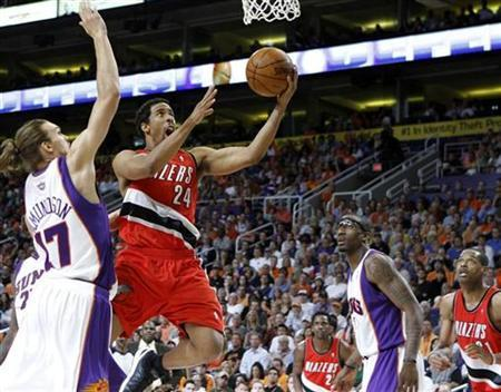 Portland Trail Blazers' Andre Miller (24) drives for a lay-up past Phoenix Suns' Louis Amundson (17) during the first half of Game 2 of their NBA Western Conference playoff series in Phoenix April 20, 2010. REUTERS/Joshua Lott