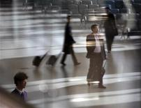 <p>Passengers reflect on a glass wall as they walk inside terminal 2 of Shanghai Hongqiao International airport on its first day of operation, March 16, 2010. REUTERS/Nir Elias</p>