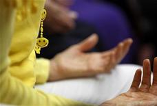 <p>A smiley face piece of jewelery worn by Dr. Funshine, aka Caroline Meeks, M.D. is seen as teaches a laughter therapy class to a group of seniors at the Clairmont Friendship Center in San Diego, California November 17, 2010. REUTERS/Mike Blake</p>