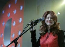 <p>Anna Chapman, a former Russian spy now working as an advisor to the president of Moscow-based FundService Bank, delivers a speech during a congress of pro-Kremlin Molodaya Gvardiya (Young Guard) movement in Moscow, December 22, 2010. REUTERS/Alexander Natruskin</p>