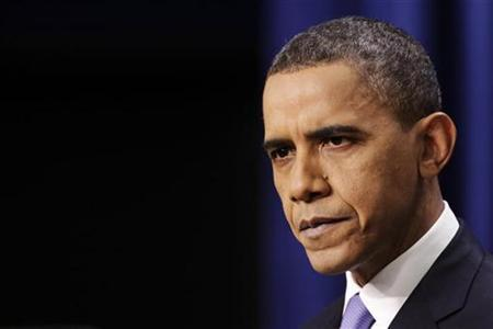 President Barack Obama listens to a question during his news conference in the Eisenhower Executive Office Building at the White House in Washington December 22, 2010. REUTERS/Yuri Gripas