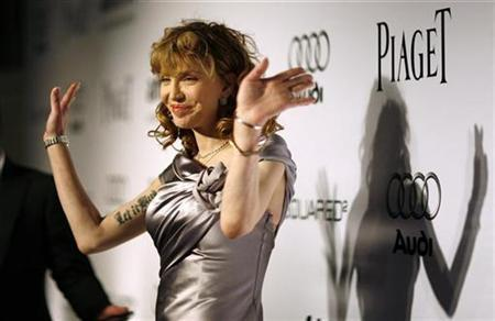 Musician Courtney Love waves at The Foundation for AIDS Research (amfAR)'s Inspiration Gala Los Angeles fundraiser in Los Angeles October 27, 2010. REUTERS/Mario Anzuoni