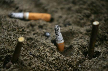 Cigarette butts fill an ashtray outside a construction site in Central, a business district in Hong Kong, October 18, 2006. REUTERS/Paul Yeung/Files