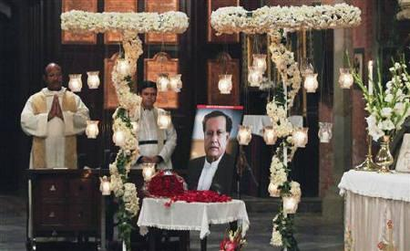 A portrait of the assassinated Governor of Punjab Salman Taseer is displayed during a Sunday service at the Cathedral Church of the Resurrection in Lahore January 9, 2011. REUTERS/Mohsin Raza
