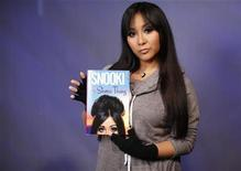 <p>Reality TV star, Nicole 'Snooki' Polizzi, poses with her book in New York, January 10, 2011. REUTERS/Brendan McDermid</p>