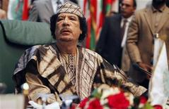 <p>Libya's leader Muammar Gaddafi sits during the closing session of the 23rd Arab League summit in Sirte March 28, 2010. REUTERS/Zohra Bensemra</p>