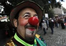 <p>A man wearing a clown costume takes part in the annual Tbilisoba City Day celebration in Tbilisi October 24, 2010. REUTERS/David Mdzinarishvili</p>