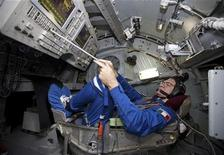 <p>International Space Station (ISS) crew member European Space Agency Astronaut Paolo Nespoli of Italy takes part in a training session for controlling Soyuz spacecraft at the Star City space centre outside Moscow November 13, 2010. REUTERS/Sergei Remezov</p>