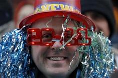 <p>Reveller David Turner from Brooklyn waits in Times Square for New Year's Eve celebrations to begin in New York, December 31, 2010. REUTERS/Gary Hershorn</p>