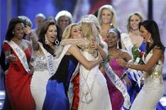 <p>Miss Nebraska Teresa Scanlan (C), 17, is mobbed by other contestants after being crowned Miss America 2011 during the Miss America Pageant at the Theatre for the Performing Arts at the Planet Hollywood Resort & Casino in Las Vegas, Nevada, January 15, 2011. Scanlan was named Miss America on Saturday becoming the youngest winner ever in the pageant's history after a night of being judged for poise, talent, fitness and knowledge. REUTERS/Steve Marcus</p>